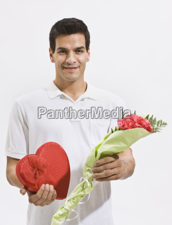 happy, man, holding, candy, and, flowers - 2831731