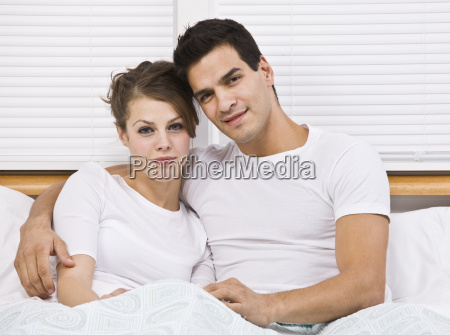attractive couple in bed together