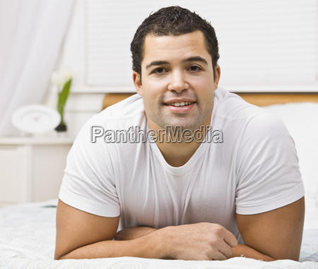 attractive man on bed