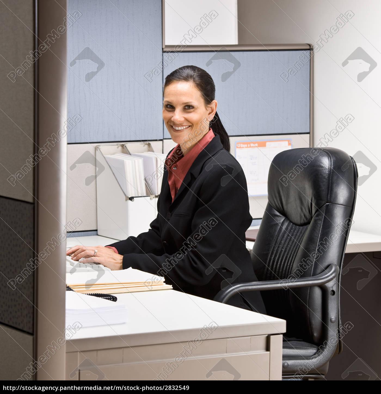 businesswoman, sitting, at, desk, smiling - 2832549