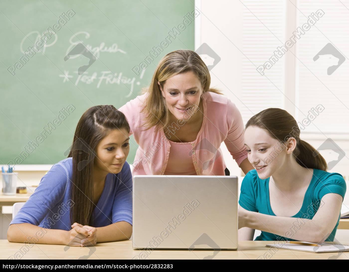 teacher, helping, students, on, laptop - 2832283