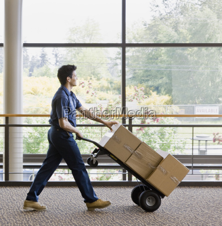 young man moving boxes