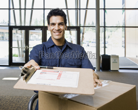 young man delivering boxes