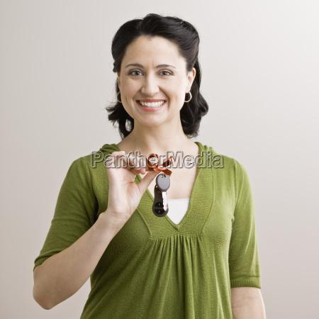 mid adult woman holding keys