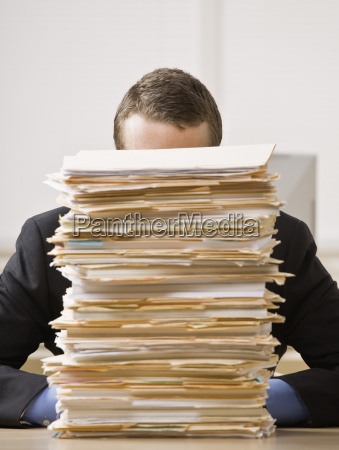 businessman, behind, stack, of, file, folders - 2834143
