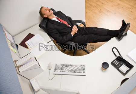 businessman, sleeping, at, desk, with, feet - 2834675