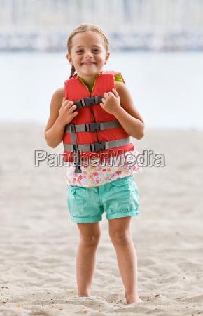 girl, wearing, life, jacket, at, beach - 2834839
