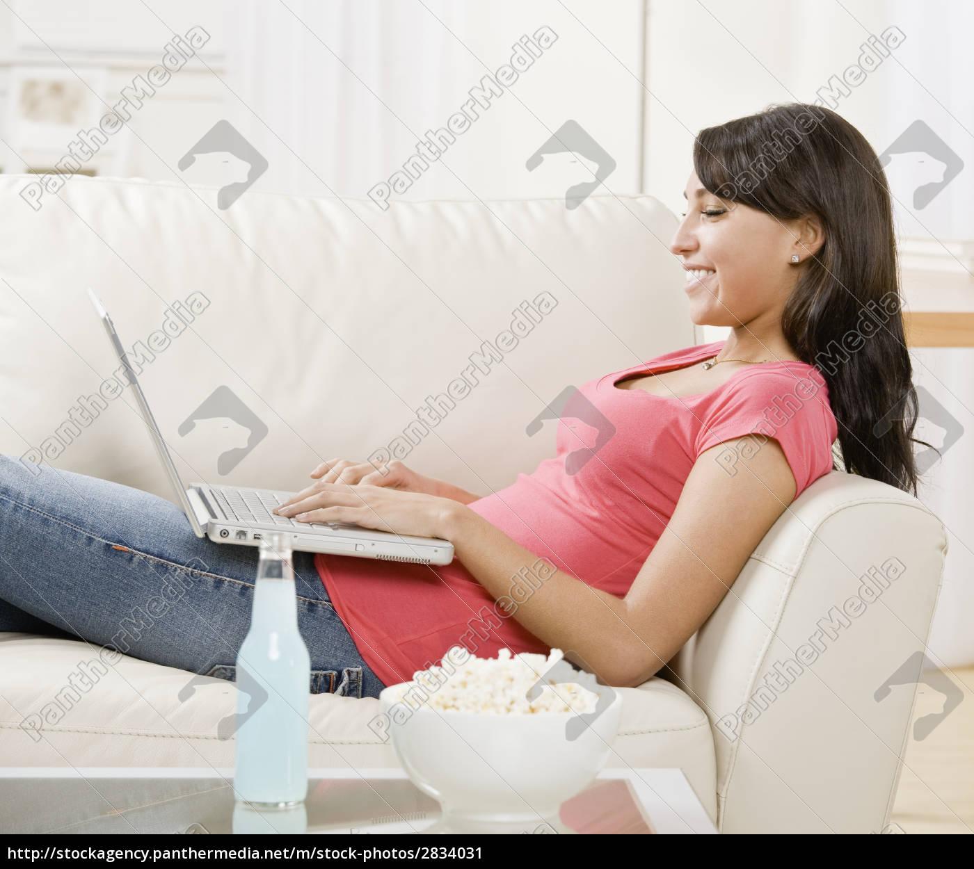 young, woman, on, sofa - 2834031