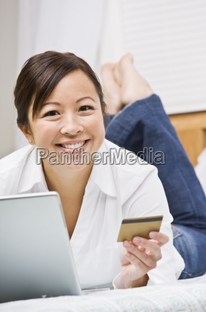 beautiful asian woman with credit card