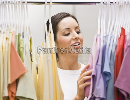 woman going through her outfits
