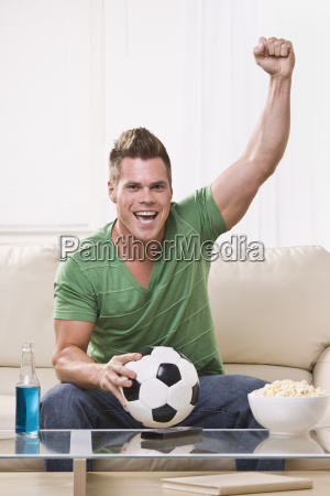 soccer fan pumping his fist while