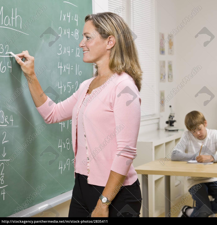 teacher, writing, on, blackboard - 2835411