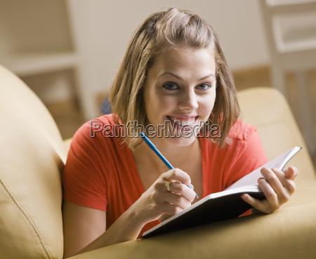 teenage, girl, writing, in, book - 2835701