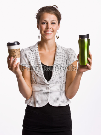 businesswoman holding coffee cups