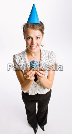 businesswoman holding birthday cupcake