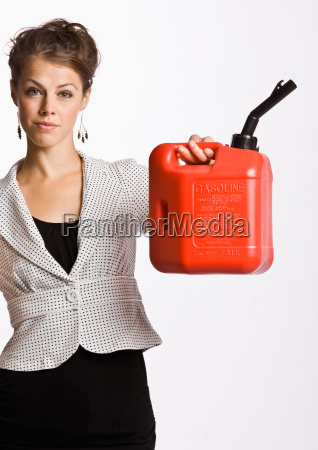 businesswoman holding gas can