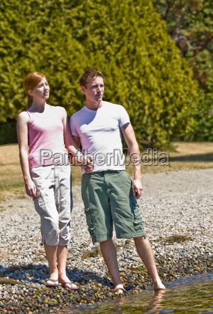 couple standing near stream