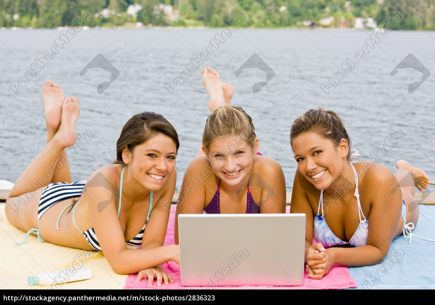friends, laying, on, pier, using, laptop - 2836323