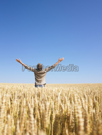 man in wheat field with