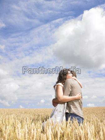 couple, hugging, in, wheat, field - 2837789
