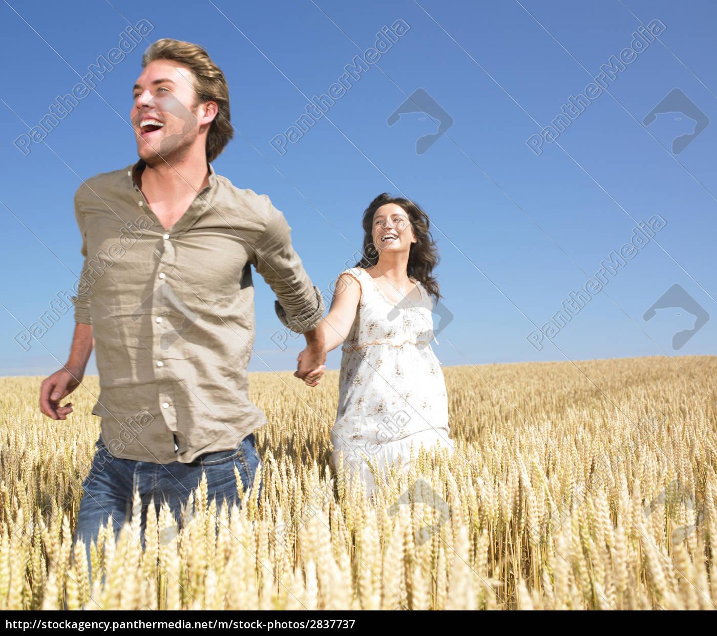 couple, running, in, wheat, field - 2837737