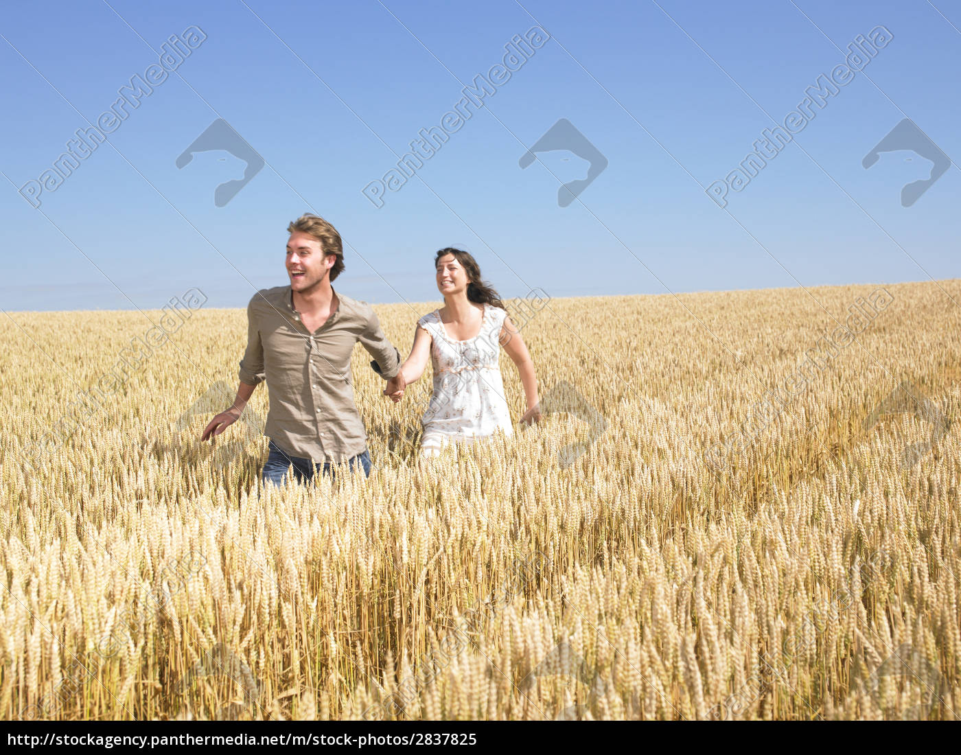 happy, young, couple, in, wheat, field - 2837825