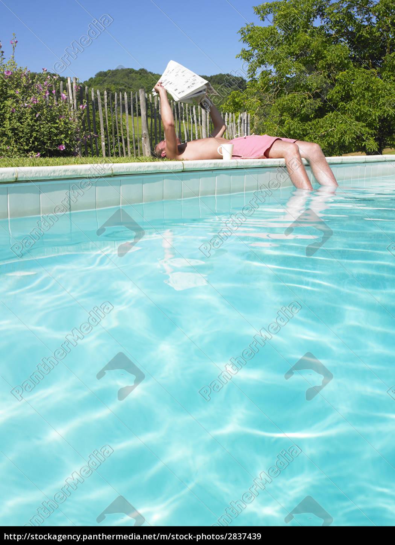 man, reading, at, edge, of, swimming - 2837439