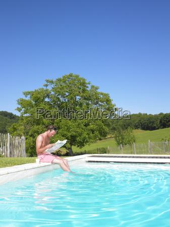 man, reading, at, edge, of, swimming - 2837493