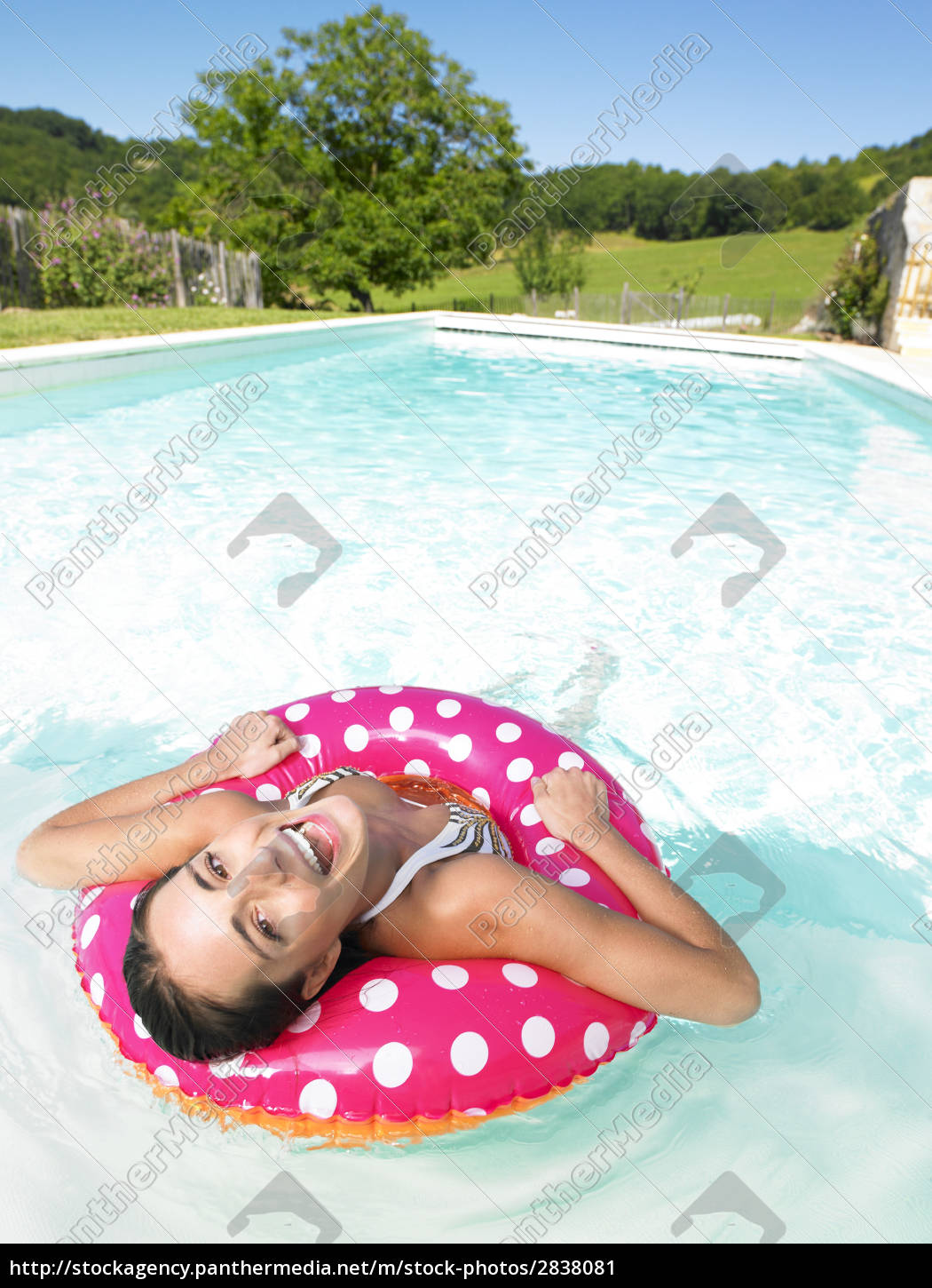 laughing, woman, floating, in, pool - 2838081