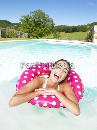 laughing, woman, floating, in, pool - 2838149