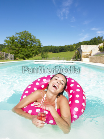 laughing, woman, in, pool, with, beverage - 2838039