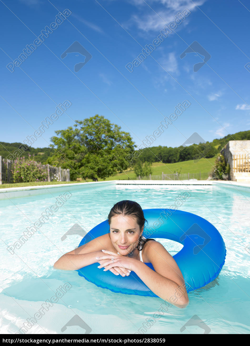 smiling, woman, floating, in, pool - 2838059