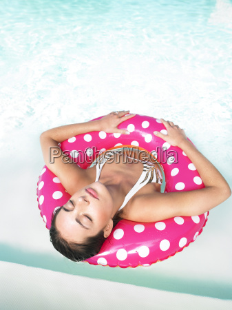 woman, floating, in, pool, with, eyes - 2838103