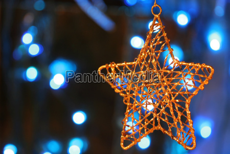 gold star ornament with christmas lights
