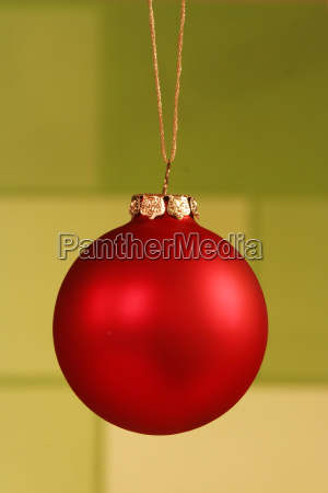 red ornament on light green background