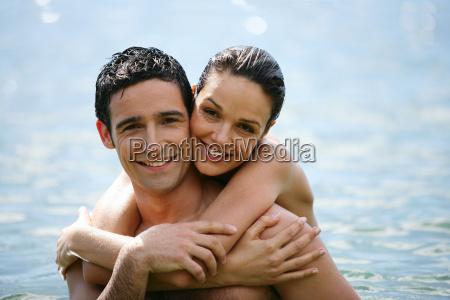 portrait of smiling couple in swimwear