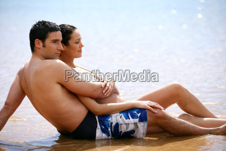 couple, extended, swimsuit, sunbathing, on, the - 2899159