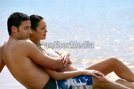 couple, extended, swimsuit, sunbathing, on, the - 2899169
