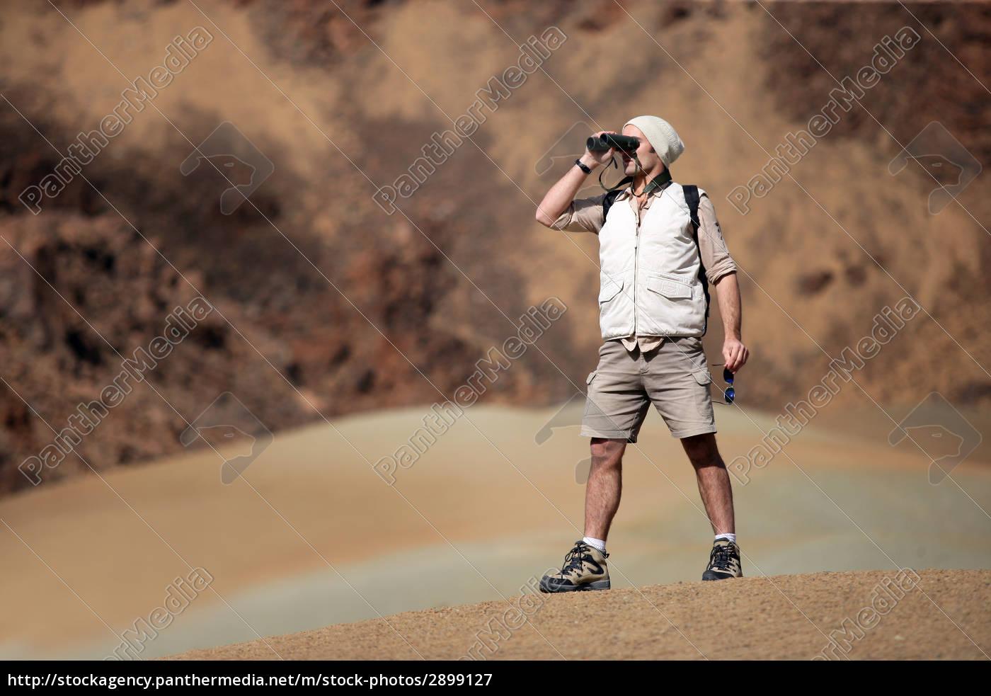 looking, man, walking, away, with, binoculars - 2899127