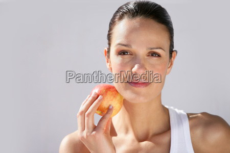 portrait, of, smiling, woman, with, apple - 2899761