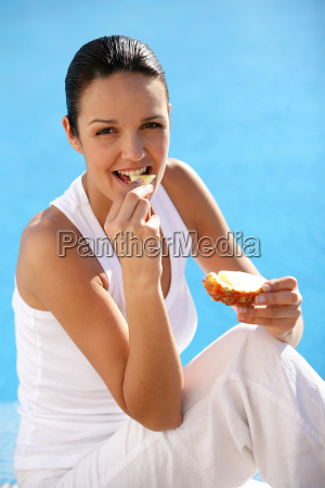 portrait, of, woman, eating, pineapple, sitting - 2899855