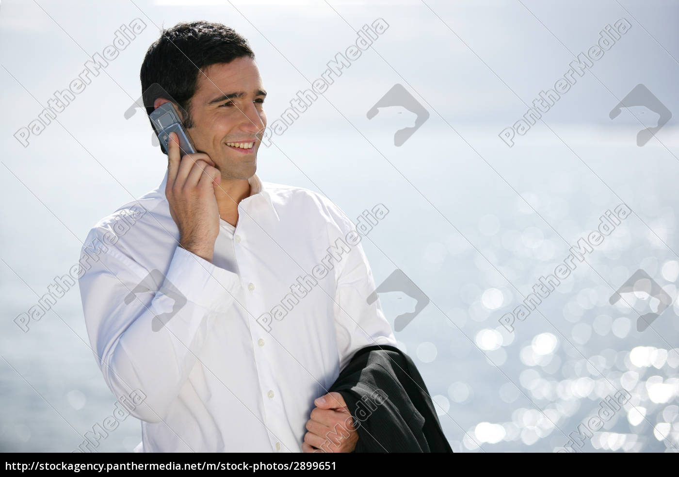 smiling, man, with, mobile, phone, back - 2899651