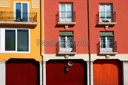 red and yellow facade with windows
