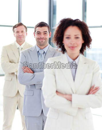 attractive businessman with folded arms in