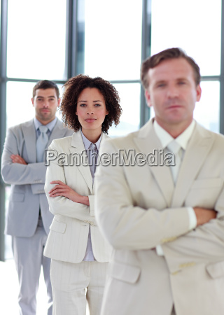 confident businesswoman with folded arms in