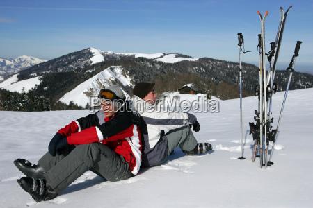 men, sitting, in, the, snow - 2905787