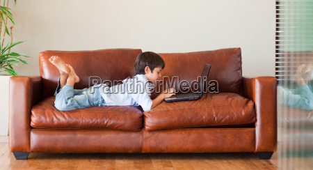 kid playing with a laptop on
