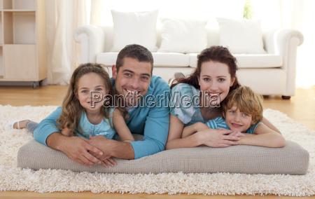 family on floor in living room