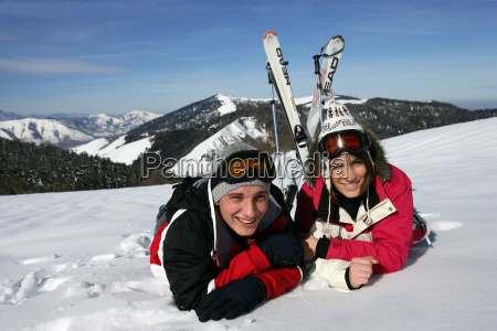 couple, lying, in, snow - 2909813