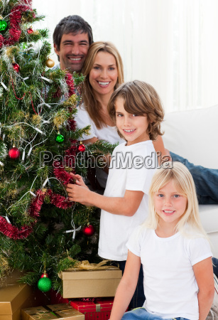 portrait of a happy family decorating